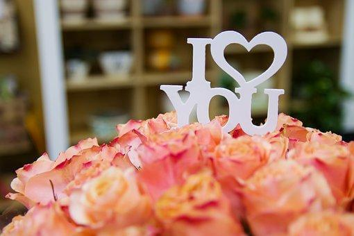 ハッピーウエディングのロゴとお花